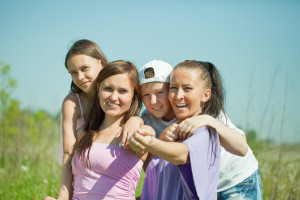Two happy women with teens